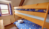 This shows the first floor pine bunk beds.