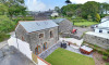 On a former working dairy farm in the heart of the Devon countryside, The Granary is a lovingly restored stone barn conversion