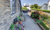 A pretty front terrace offers lovely village and hillside views