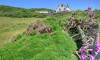 Perched on a hillside in the delightful cliff top village of Mortehoe, this imposing detached residence is in a unique position