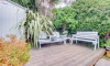 Fully enclosed terraced patio garden ideal for relaxation and alfresco dining