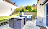Lovely patio area with seating, hot tub and BBQ