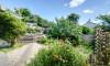 Pretty gardens surround the dormer bungalow