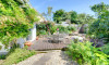 Lovely enclosed mature terraced patio garden at the rear of the property has a large patio area, ideal for alfresco dining