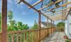 The decked verandah that runs along the whole length of the house