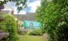 Pretty walled garden, lawn and garden furniture.
