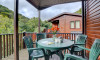 The covered verandah and patio area at the side of the lodge extends the living space and is a great spot for al fresco dining