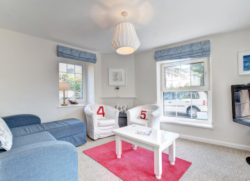 Living space: Bright sunny room overlooking the park. Corner sofa and 2 chairs, coffee table, TV, DVD player, wooden chest with board games and DVD's.