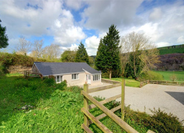 Wonderful setting with views across to a delightful wooded river valley.