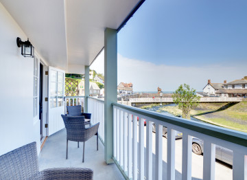 The full length canopied balcony offering river, sea and countryside views