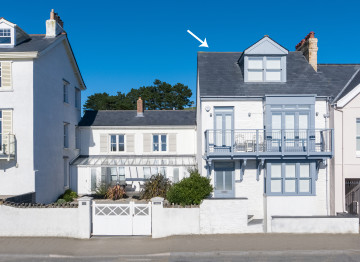 This recently refurbished beach villa has been well designed, thoughtfully furnished and stylishly presented throughout