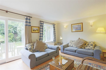 This light sitting room enables you to access the garden and the dining room with ease.