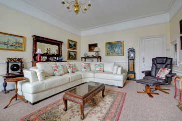 Classically furnished sitting room with lots of charm and elegance