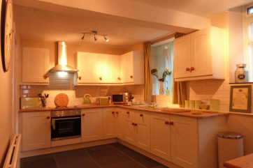 The large kitchen includes a brand new oven, hob & microwave