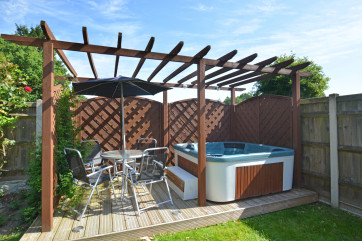 Another added extra that comes with this property is the use of the hot tub in the garden