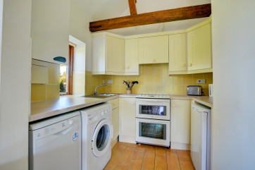 Well equipped kitchen area joining the sitting room
