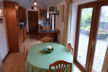 Large kitchen diner with patio doors and view of Moel Siabod.