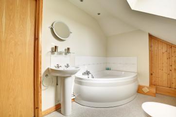 Lovely bathroom with luxurious corner bath