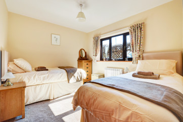 The ground floor double bedroom is light and spacious with twin beds