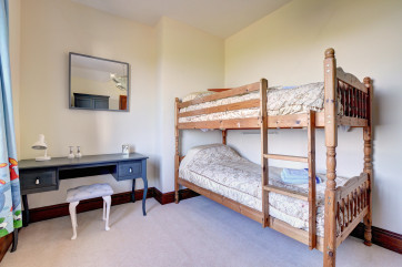 Bunk-beds in bedroom 3 which overlooks the sea