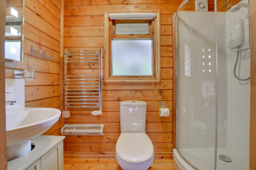 Bathroom includes an electric shower and a heated towel rail