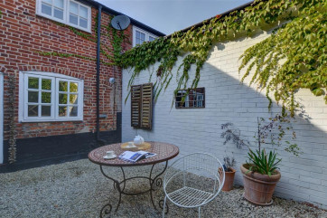 An outdoor dining area, perfect in the summer for relaxing in the sunshine with a glass of wine.