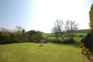 A lovely lawned garden with far reaching views