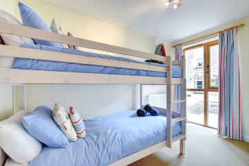Bedroom three features a set of comfortable bunk beds, sure to be very popular with younger members of the family!