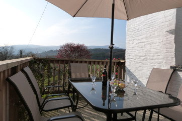 Decking area with garden furniture for up to 10 guests