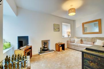 Snug: Sofa Bed(double), Wardrobe, LG TV, large chess set.