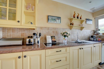 The kitchen is well equipped and has a useful utility room