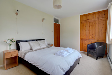 The master bedroom has a comfortable double bed