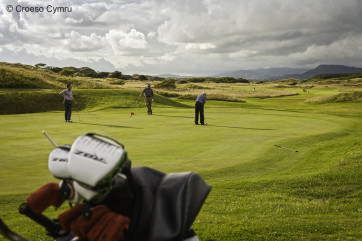 The world famous Royal St Davids Golf Course between Harlech Castle and the beach