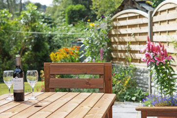Patio area with garden furniture in a beautiful, tranquil setting