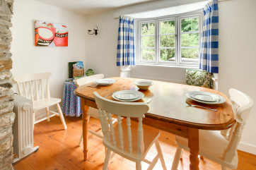Dining table with cottage window looking over the front garden