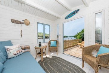 The garden has the benefit of a brand new summer house with double bed settee, wicker furniture and games.