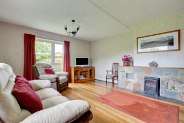 The sitting room has a feature stone fireplace with an electric fire for those cooler evenings