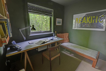 Enjoy some quiet time in this military style snug on the ground floor and you can use the desk to pen some letters to home.