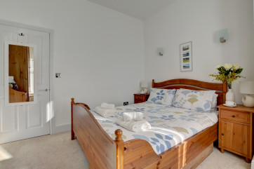 The master bedroom with pine furniture