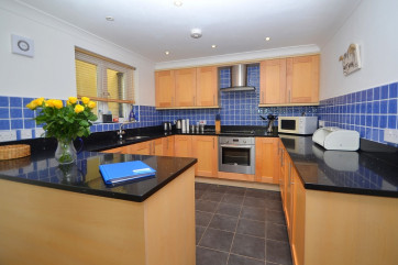 Kitchen: Contemporary and open-plan, well equipped with a washer/dryer, dishwasher, fridge, freezer and electric oven with hob and microwave.