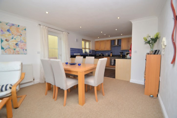 Dining area: Between the kitchen and the living area. Dining table and 6 chairs.