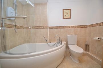 Bathrooms: Family bathroom with large corner bath, electric shower over bath, wash basin, W.C., heated towel rail.
