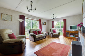 The spacious, light and airy dual aspect living room offers wonderful countryside views
