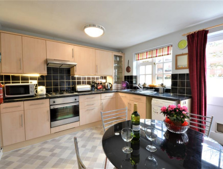 Kitchen/Dining Room: At the rear of the property with access leading out to the rear courtyard. Fitted electric cooker with gas hob, washing machine and free-standing fridge with freezer compartment. Dining table and 4 chairs.