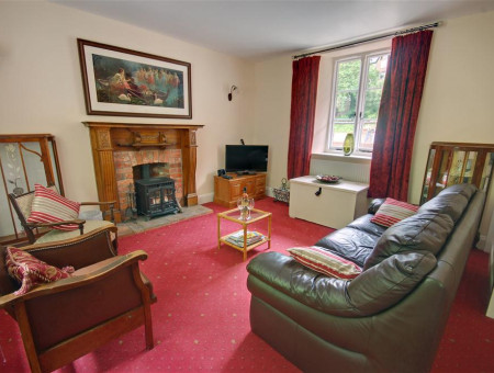 An eclectic mix of furnishings in this cosy sitting room