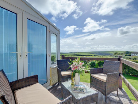 The apartment has a lovely terrace area, perfect for enjoying a glass of wine together at the end of the day