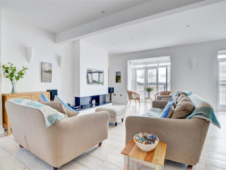 The spacious open plan living room is on the first floor to take advantage of the wonderful views