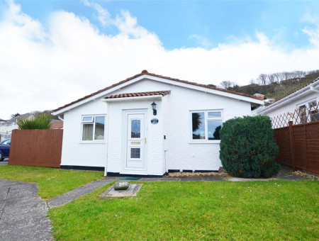 Summer Breeze is a delightful detached bungalow with lovely distant sea views