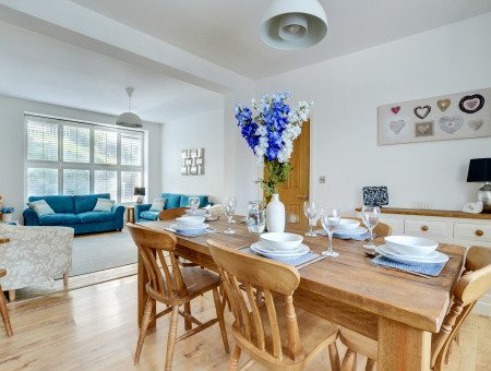 The dining room and sitting room are perfect areas to get together and socialise
