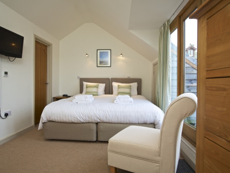 Master suite: Double bed, bedside units, wardrobe and chest of drawers.